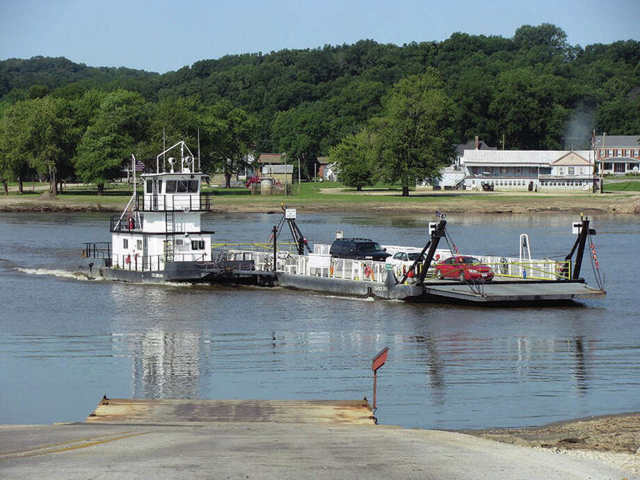 Beverly Watkins | Reader photo Several vehicles are ferried across the river at Kampsville. Their passage was delayed briefly while the ferry was re-fueled.