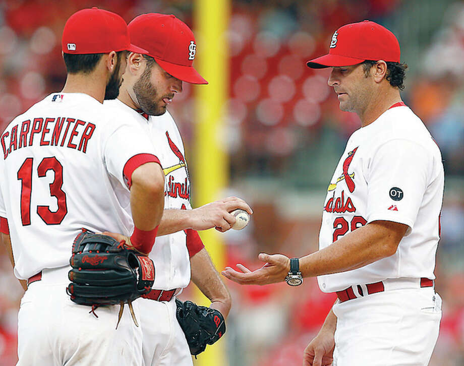 Cardinals starting pitcher Lance Lynn, center, is pulled by manager Mike Matheny, right after allowing seven Pittsburgh runs in the first inning Thursday at Busch Stadium. Photo: Billy Hurst | For The Telegraph