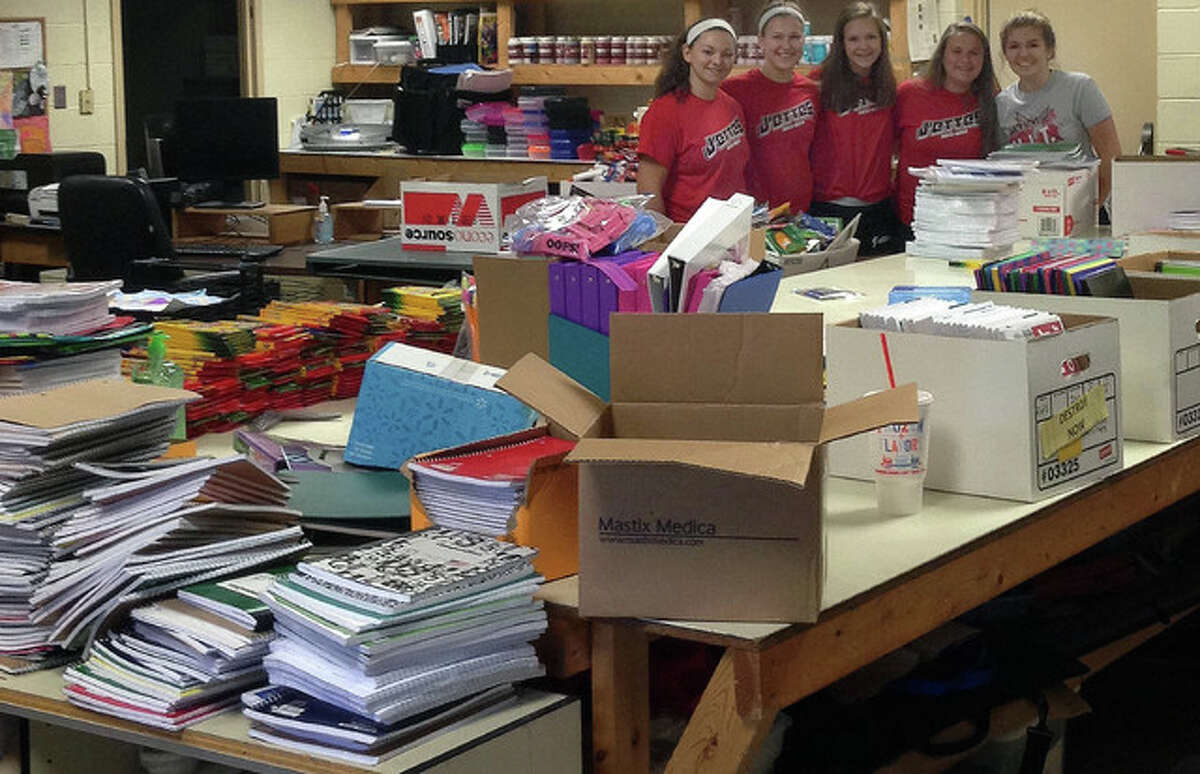 Photo provided Members of the Jacksonville J'ettes help sort and organize school supplies collected by the Lions Club so the supplies can be distributed to schools. The Jacksonville Lions Club collected donations two weekends in a row outside of Walmart.