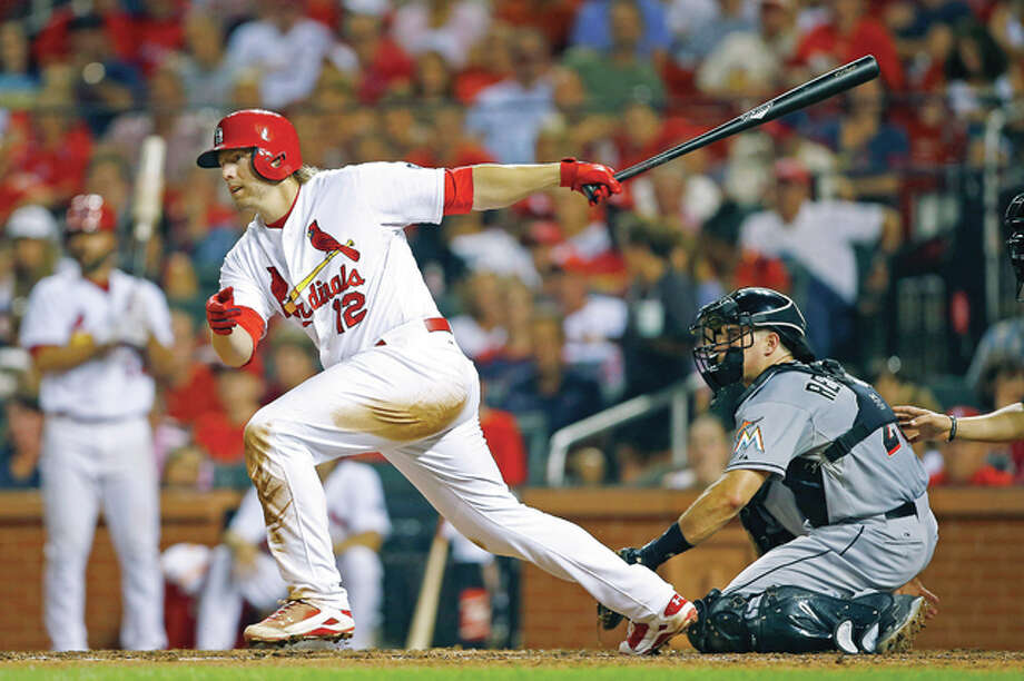 The Cardinals' Mark Reynolds hits an RBI single to left field, driving in Randal Grichuk in the seventh inning Friday at Busch Stadium.