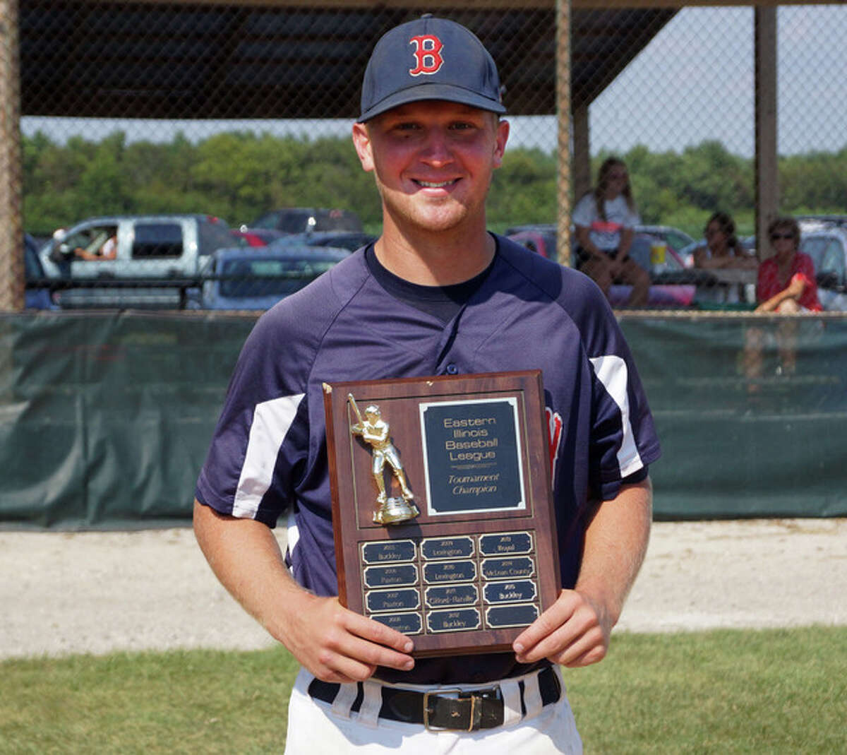 Carrollton grad Josh Krumwiede shows off the trophy after the Buckley Dutchmasters beat the Royal Giants 6-1 for the team's second Eastern Illinois League tournament title in the past four years.