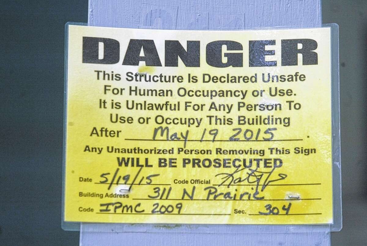 Jacksonville's inspections department posted this warning sign at 311 N. Prairie St. three months ago.