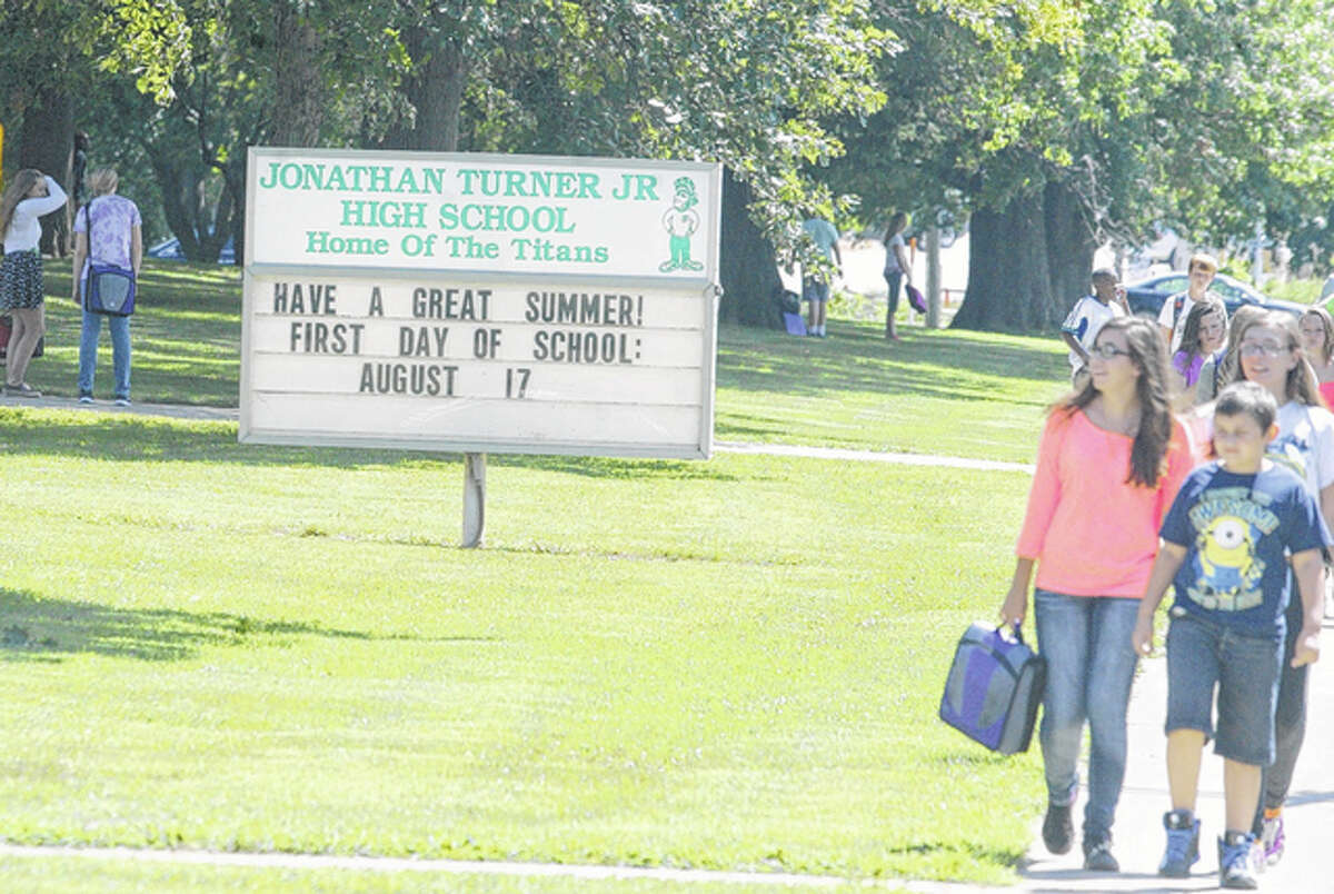 Students leave Turner Junior High after the end of the school day Thursday.