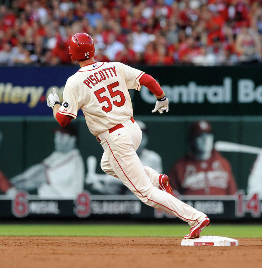 The Cardinals' Stephen Piscotty rounds second base on his way to third after the ball was bobbled on his double in the second inning Saturday night at Busch Stadium. Photo: AP