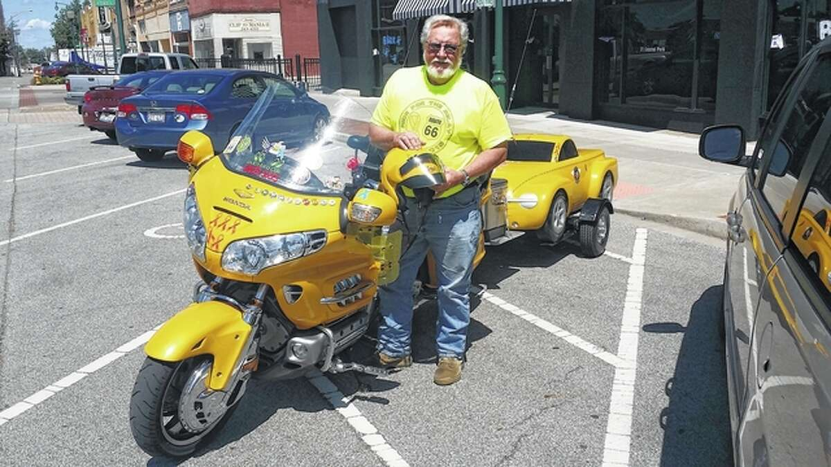 Rodger Fox's yellow Honda Goldwing motorcycle is adorned with ribbons with the names of loved ones written on them as well as pins commemorating each Ride for the Relay trip.