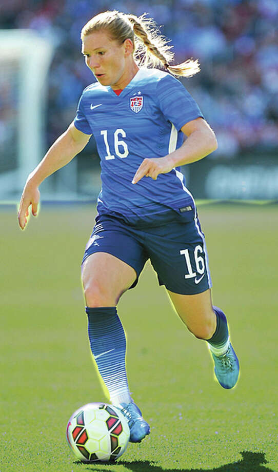 St. Louisan Lori Chalupny, shown here in action for the US Women's National Team last May in St. Louis, will retire from international soccer at the end of 2015. Photo: Bill Greenblatt, UPI | For The Telegraph