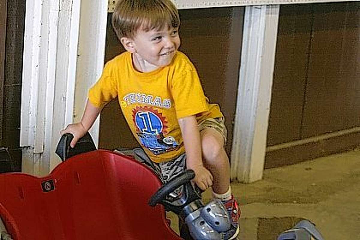 Brec Suter, 3, of Jacksonville, checks out his car Friday at the Jacksonville Speedway during Fan Appreciation Night.