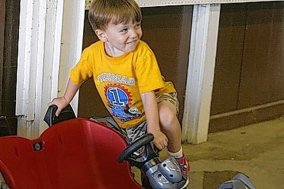 Brec Suter, 3, of Jacksonville, checks out his car Friday at the Jacksonville Speedway during Fan Appreciation Night. Photo: Samantha McDaniel-Ogletree | Journal-Courier