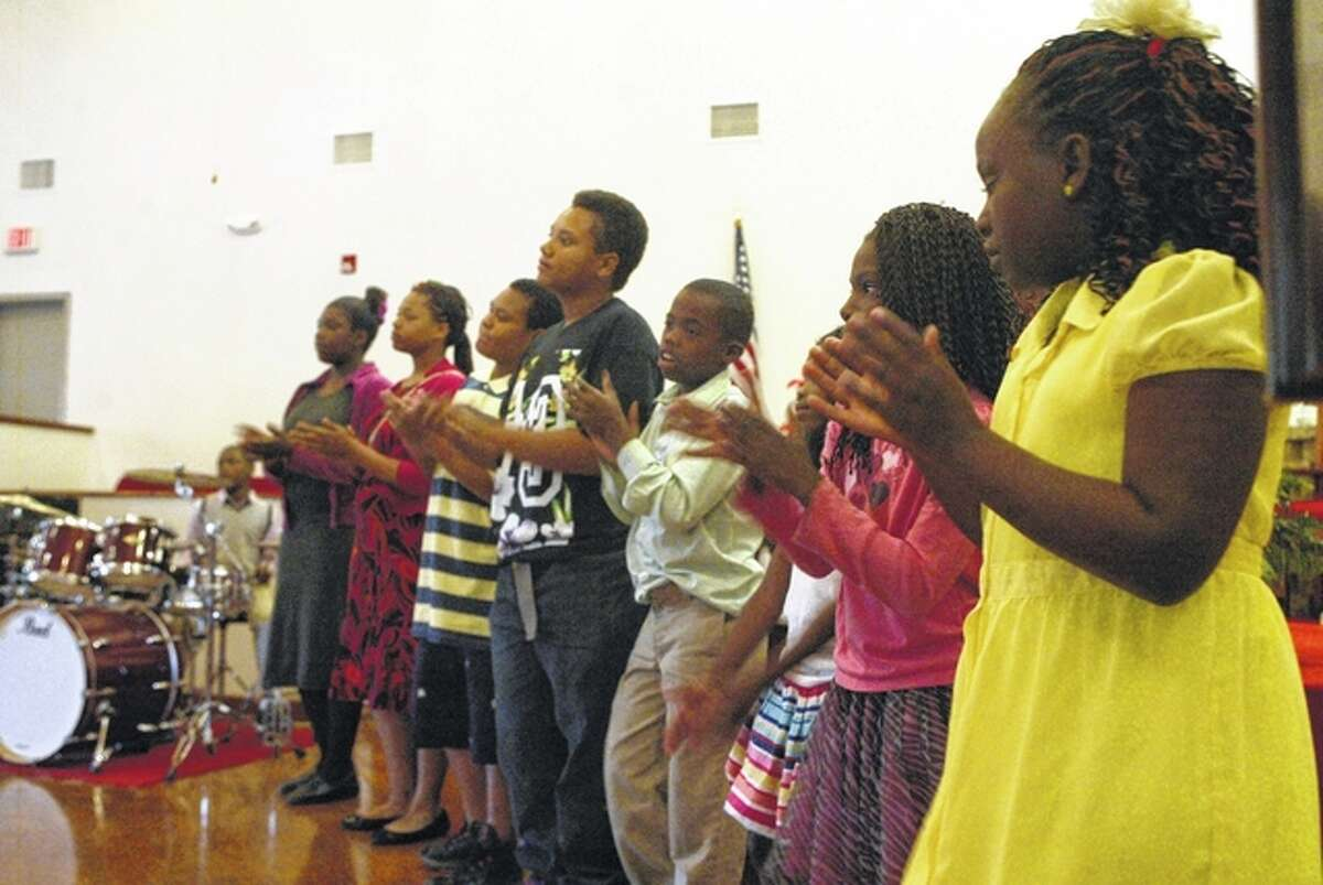 Youth from Tabernacle of Praise of Springfield sing Saturday at Community Temple Church of God in Christ in Jacksonville.