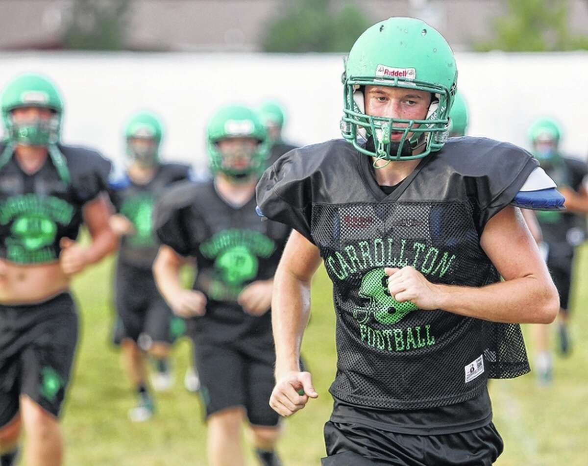 The Carrollton Hawks run at the end of a recent practice.
