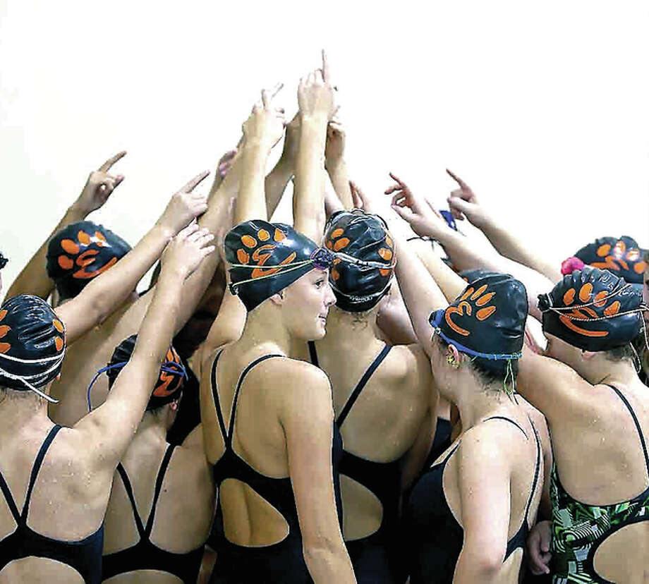 The Edwardsville High School girls swim team, shown here last season, is looking to repeat as sectional meet champion.
