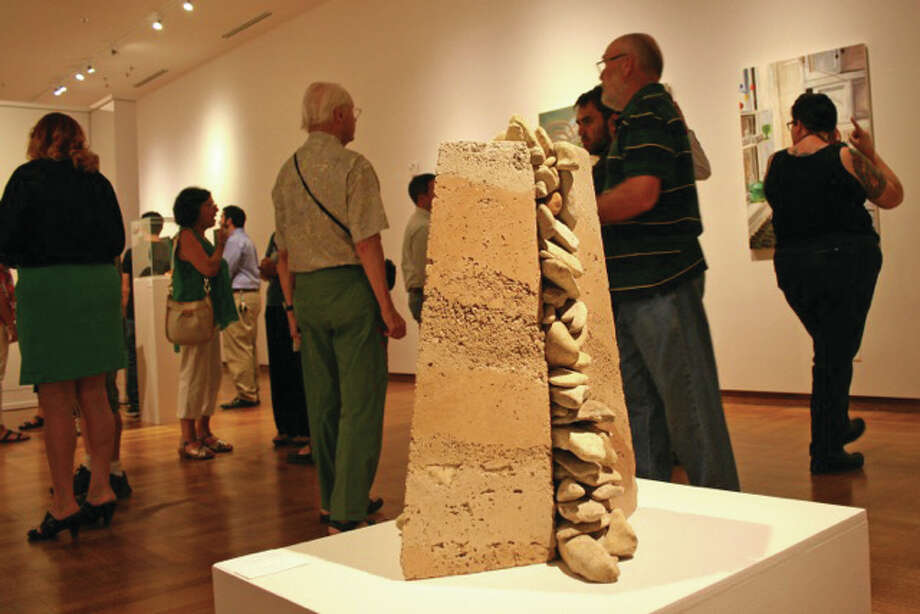 """Elsah artist Danne Rhaesa created the pictured piece titled """"Force,"""" and it is made of stone and concrete. Rhaesa's piece won the second place award in the 26th Cedarhurst Biennial Art Competition Exhibition that opened Sunday, Aug. 16, at Cedarhurst Center for the Arts in Mount Vernon, Ill. For The Telegraph"""