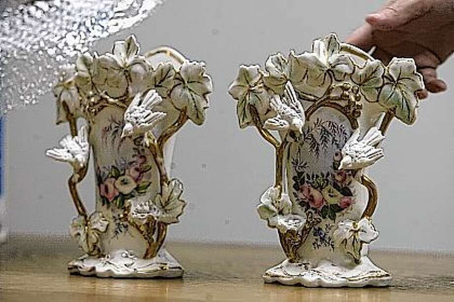 "A pair of ""Old Paris"" vases from the early 1900s. Appraised at $50 for the pair."