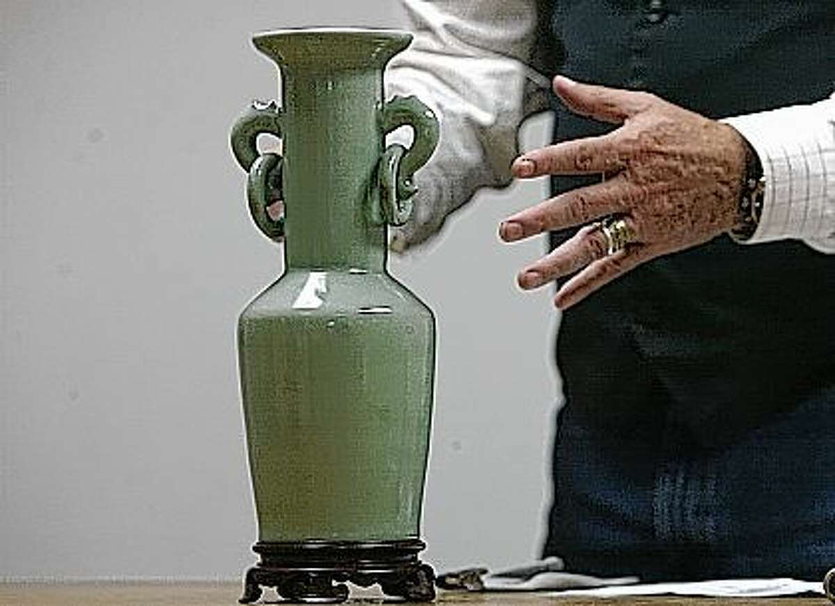 A Celadon vase with a stand. Appraised at $200.