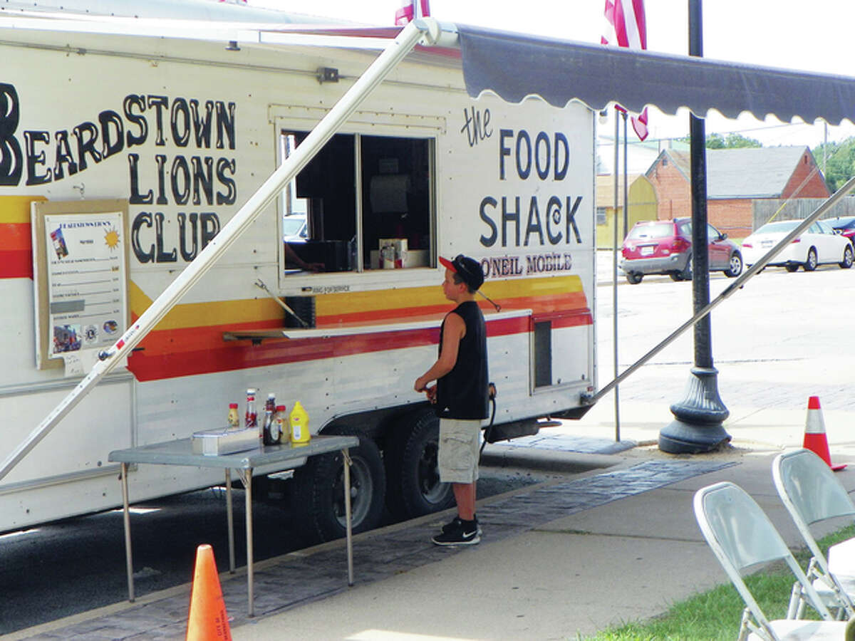 A visitor to the 2014 Taste of Beardstown event awaits his order at the Lions Club food truck. The popular event returns Saturday to Beardstown's Art Zeeck Park.