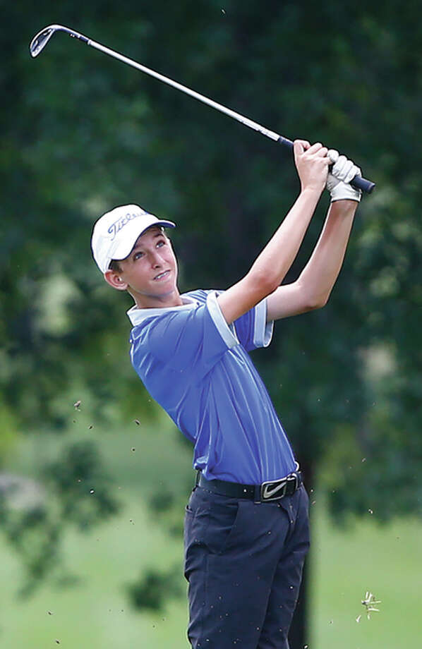 Marquette freshman Kolten Bauer, shown hitting a shot before rain washed out the Alton Tee-Off Classic on Tuesday at Spencer T. Olin in Alton, posted an 81 Thursday at Gateway National in Madison to help the Explorers win the Madison County Tourney. Photo: Billy Hurst / For The Telegraph