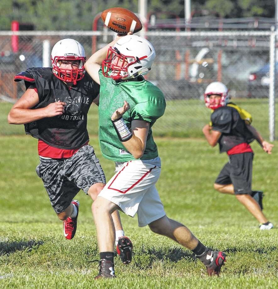 Jacksonville runs a play during a recent practice. Photo: Dennis Mathes | Journal-Courier