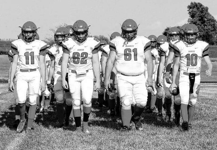 Pittsfield players march onto the field for a team photo. Photo: Dennis Mathes | Journal-Courier