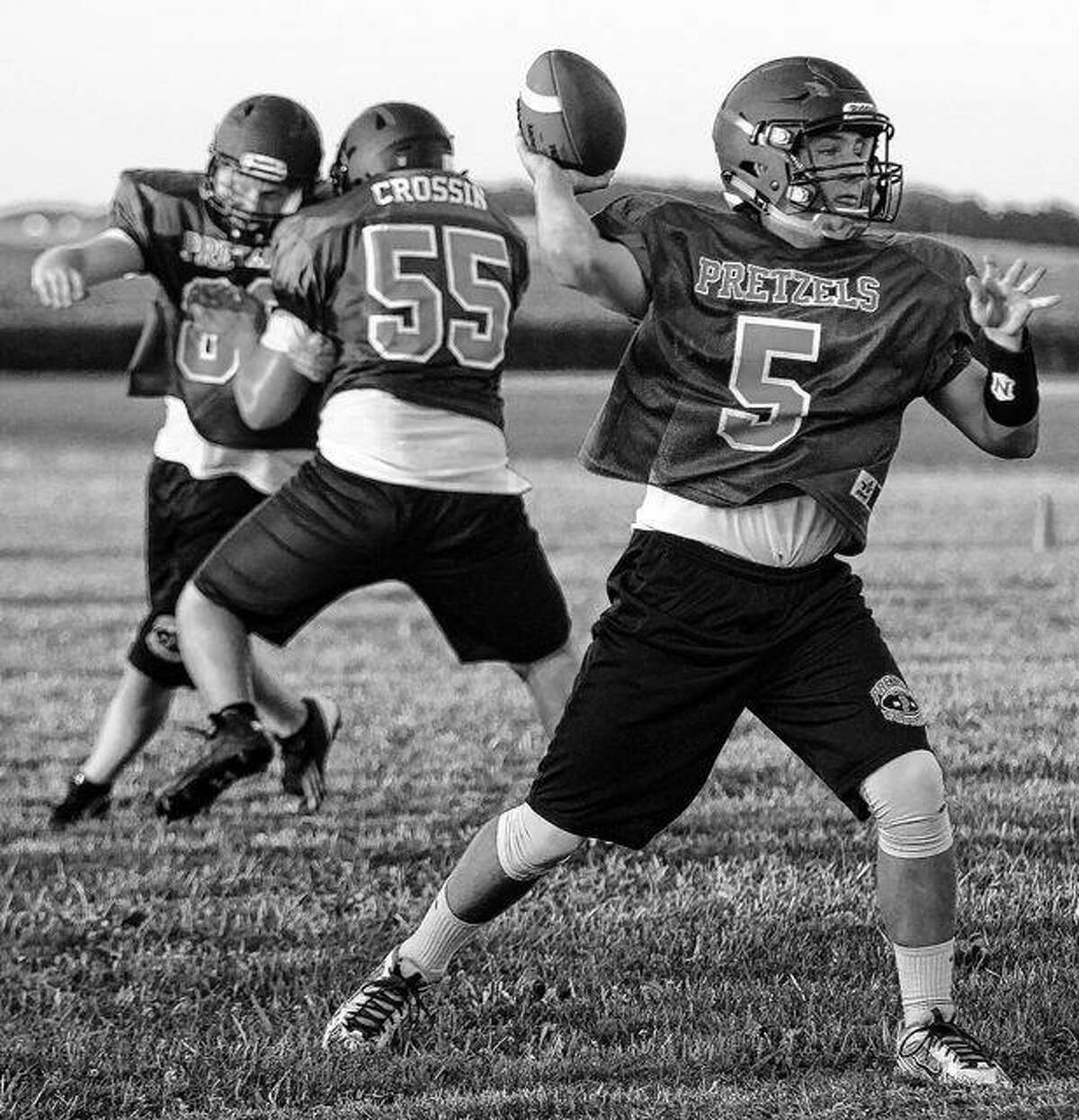 New Berlin's Cam Cummings delivers a pass during a recent practice.