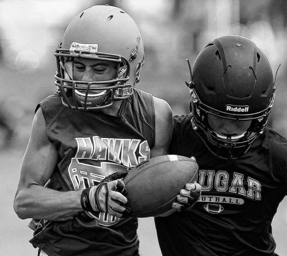 A Carrollton player grabs a pass during a 7-on-7 at Illinois College earlier this summer. Photo: Dennis Mathes | Journal-Courier