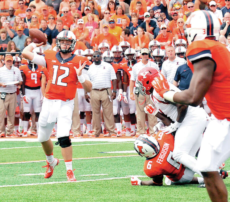 Illini quarterback Wes Lunt, shown in action in 2014, has returned after suffering a fractured leg last season. Photo: Cary Frye | For The Telegraph