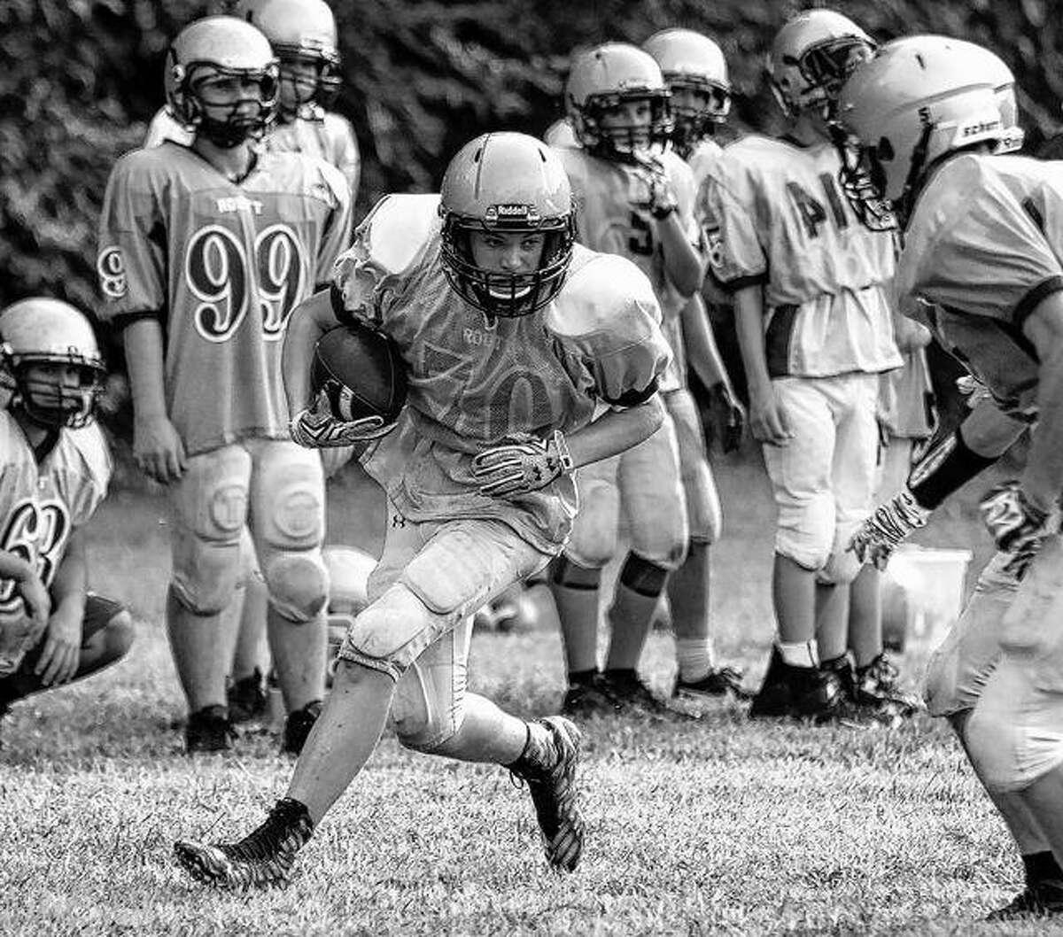 Routt's offense runs a play during a recent practice.