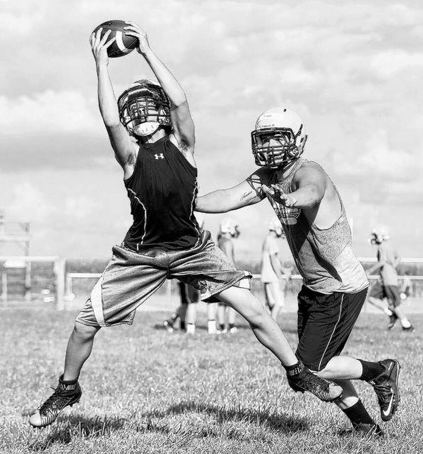 A Triopia player makes a catch during a recent practice. Photo: Dennis Mathes | Journal-Courier