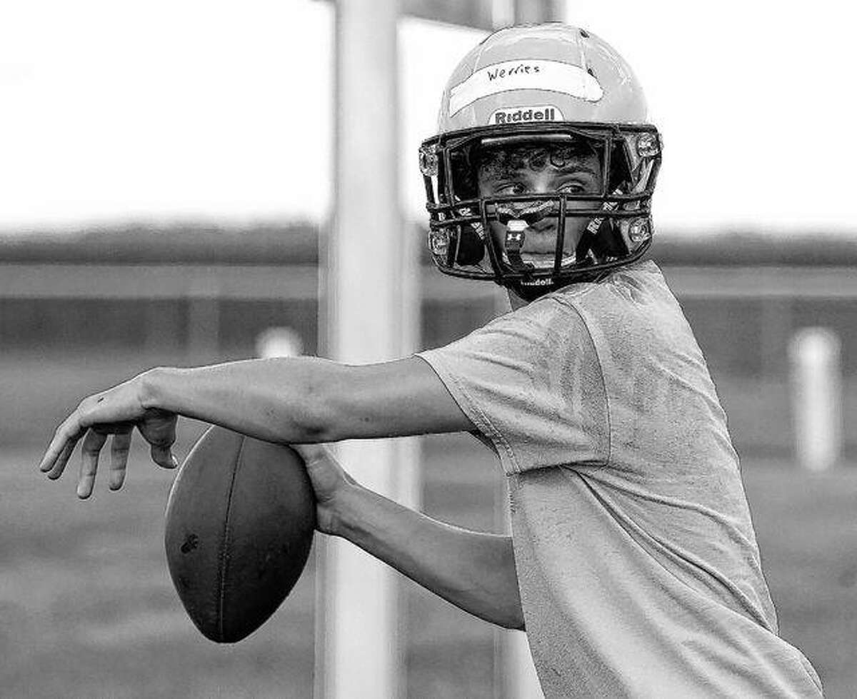 Triopia quarterback Isaac Werries looks for a target during a recent practice.