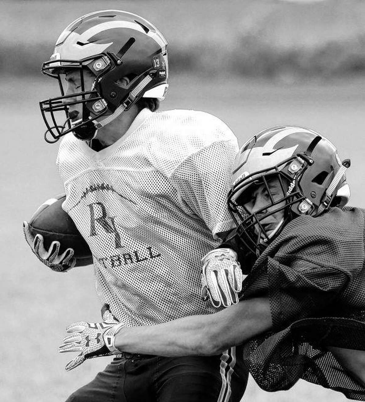 A Rushville-Industry ball carrier tries to break away during a recent practice.