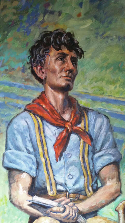 Florida artist David Bellm returned to his home town of Carlinville to dedicate a portrait of Lincoln, pictured, commissioned by Cherry Tree Collectibles' owner Jeff Kufa. It now hangs above the storefront which is adjacent to another Carlinville building featuring Bellm's work. He painted the other Lincoln portrait for the Verticchio Law Firm. Both buildings are in the town's central square.