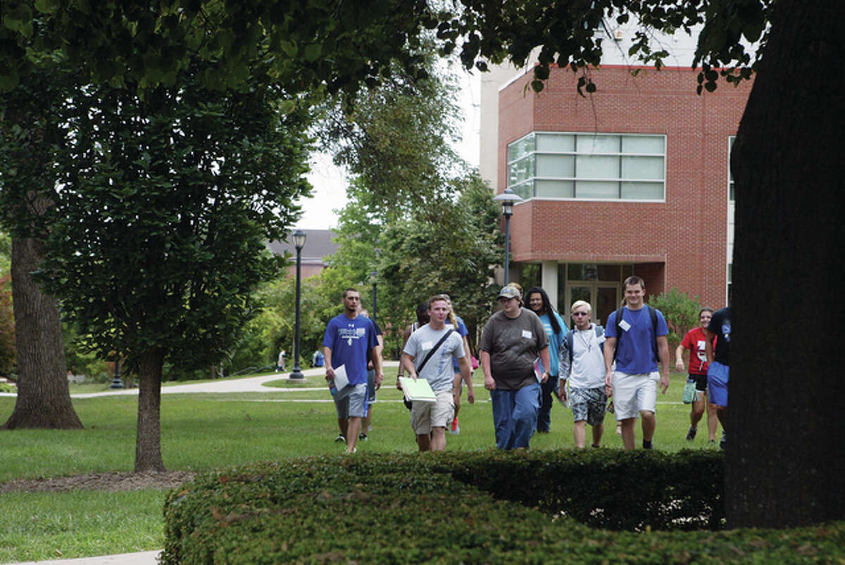 Freshmen and transfer students walk across Illinois College's upper campus Friday on their way to meetings about welcome week activities at Illinois' oldest college. IC classes begin Tuesday.
