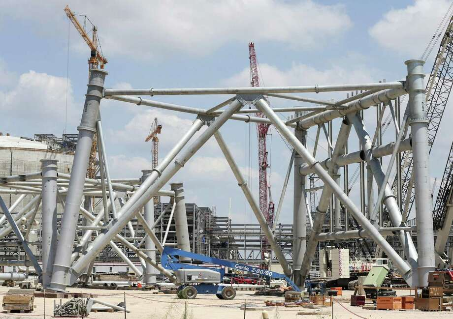A lift is dwarfed by the base of a 500-foot flaring tower at the Cheniere Liquid Natural Gas plant construction site in Portland, Texas, Wednesday, August 2, 2017. The complete project will have a cost of over $20 billion. The plant will have three trains that will chill the natural gas to -260 degrees Fahrenheit that turns it to a liquid stage in order to transport. Photo: JERRY LARA / San Antonio Express-News / San Antonio Express-News