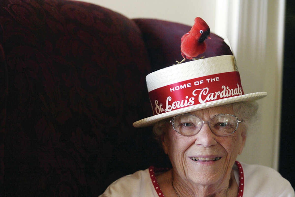 Mary Brockhouse of Jacksonville shows off her sense of humor along with a Cardinals hat she purchased when she attended the 1968 World Series with her husband. A life-long baseball fan, Brockhouse grew up in rural Chapin, hitting baseballs fast-pitched to her by a cousin and listening to the St. Louis team's games on the radio.
