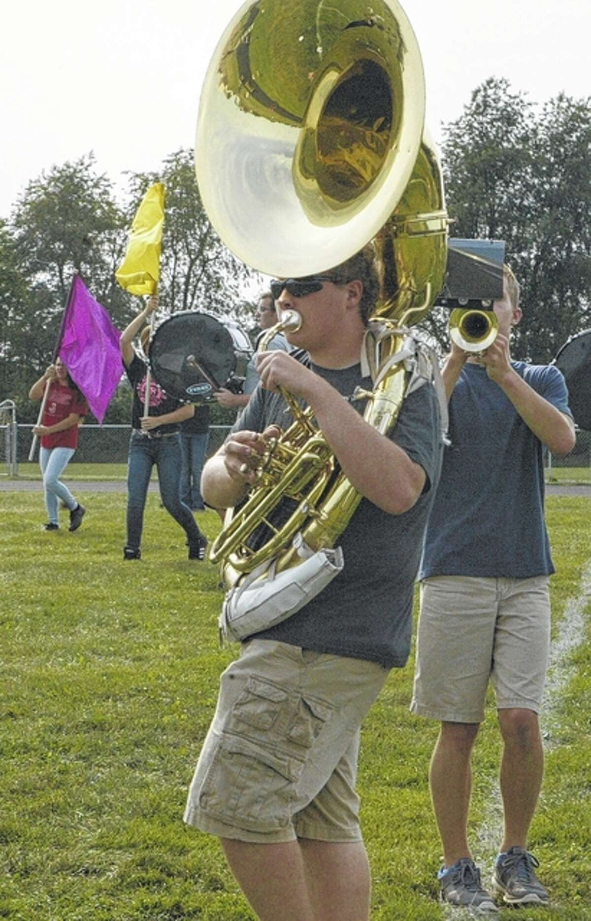 Members of the Jacksonville Marching Crimsons practice ahead of their performance at the Sept. 11 home football game.
