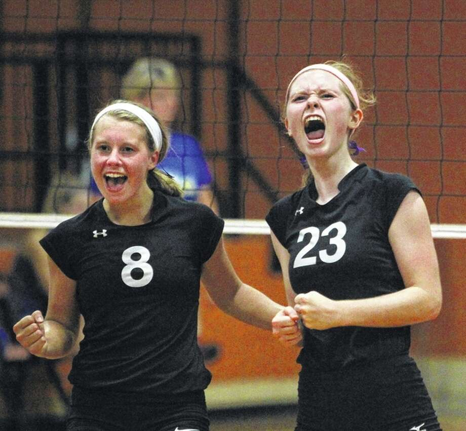West Central's Sara Piechowski (left) and Michelle Brown celebrate a point in a win over Pleasant Hill at Meredosia Monday night. Photo: Dennis Mathes | Journal-Courier