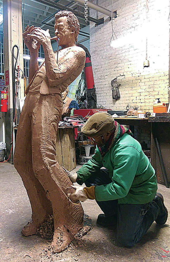Sculptor Preston Jackson works on the Miles Davis statue in his Peoria studio. The statue will be unveiled in downtown Alton Sept. 12.