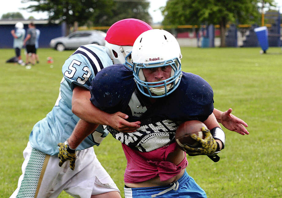 Jersey's Jonathan Pirtle is tackled up by teammate Jon Woeffel during practice. Photo: James B. Ritter | For The Telegraph