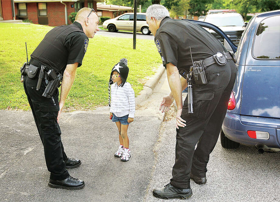 Alton police had to bend low to talk to the child after she emerged from the car on her own while police were searching for the man who took her. Police searched a wooded area on the east side of Belle Street for the suspect for about 30 minutes before he returned to the scene and was promptly arrested.