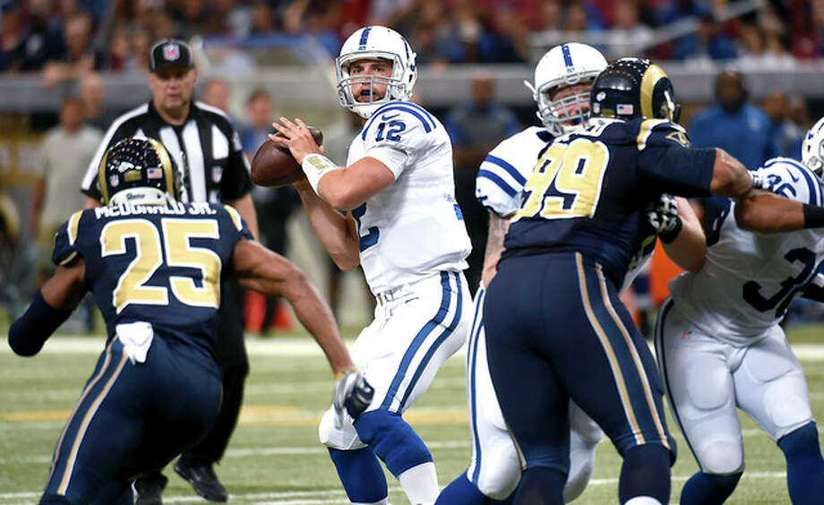 Indianapolis Colts quarterback Andrew Luck looks to throw against the Rams in the first quarter Saturday at the Edward Jones Dome. Photo: AP