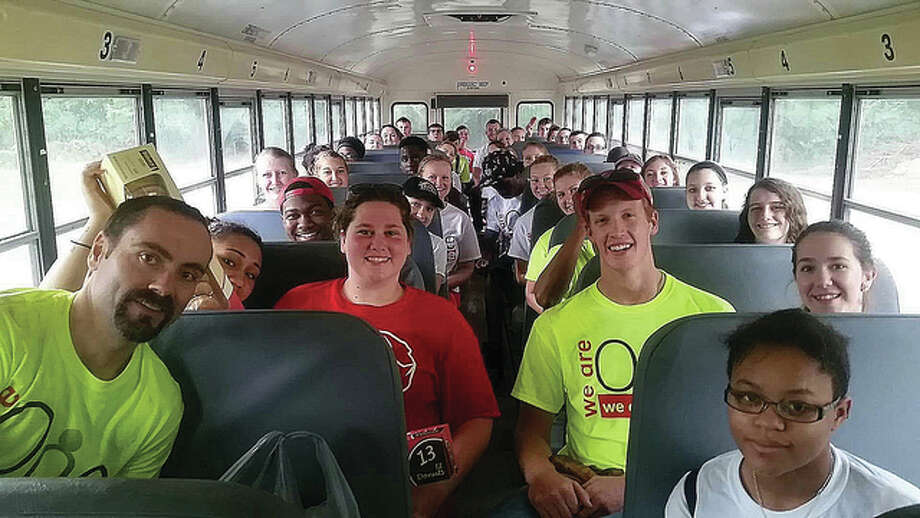 SIUE's David Hagedorn, left, assistant director of Campus Recreation, is on a bus of approximately 50 students headed to Willoughby Heritage Farm in Collinsville. Photo: Submitted Photo