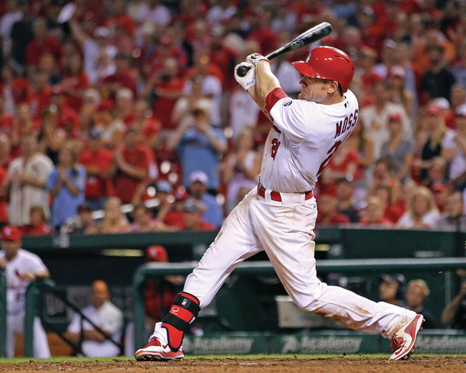 The Cardinals' Brandon Moss hits a walk-off three-run home run in the bottom of the ninth inning to defeat the Washington Nationals on Tuesday night at Busch Stadium. The Cardinals won the game 8-5. Photo: Billy Hurst / For The Telegraph