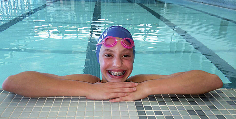 Eleni Kotzamanis of the TCAY Tidalwaves won the Penny Taylor Award for the most outstanding swimmer at the Ozark Swim Championships. She was the second consecutive TCAY swimmer to win the award. Teammate Matthew Daniel was the 2014 winner. Photo: Telegraph Photo