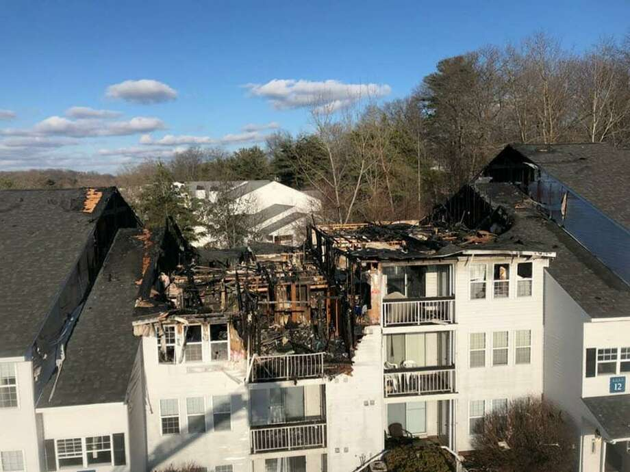 A fire that began on a third-floor balcony Thursday morning destroyed a 24-unit apartment complex on Town Colony Drive in Middletown. Twenty-five people, including 10 children, had to find shelter elsewhere. Photo: Westfield Fire District Photo