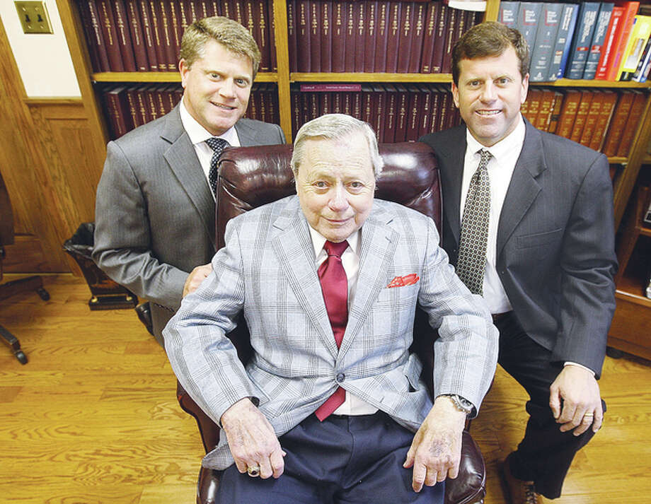 The Stobbs men, John Dale Stobbs II, left, his brother and Madison County Associate Judge Stephen Stobbs, right, and their father, John Dale Stobbs, center, have a long history of service to the legal profession.