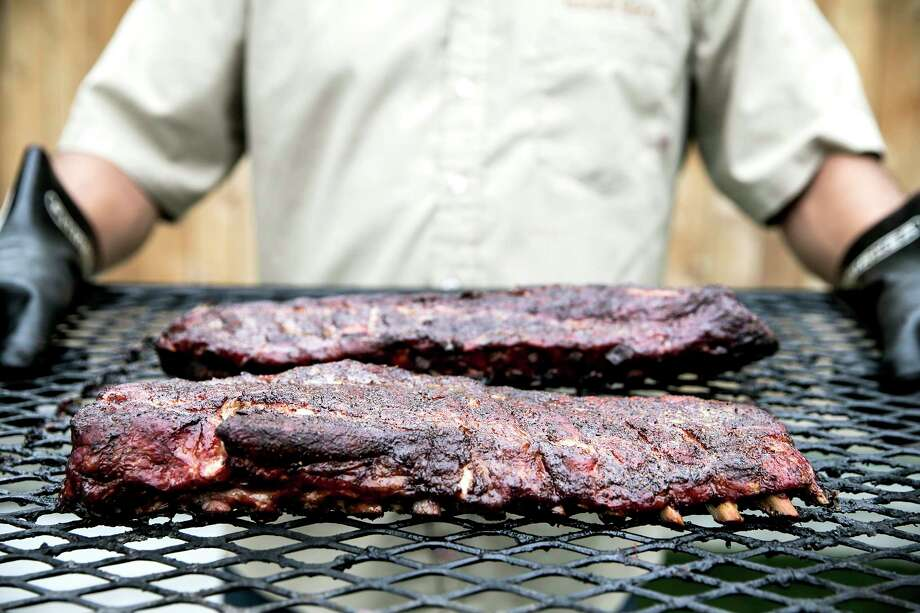After brisket, pork ribs are the second-most-popular item on barbecue-joint menus, bringing in a healthy profit margin. Photo: Elizabeth Conley, Staff / © 2016 Houston Chronicle