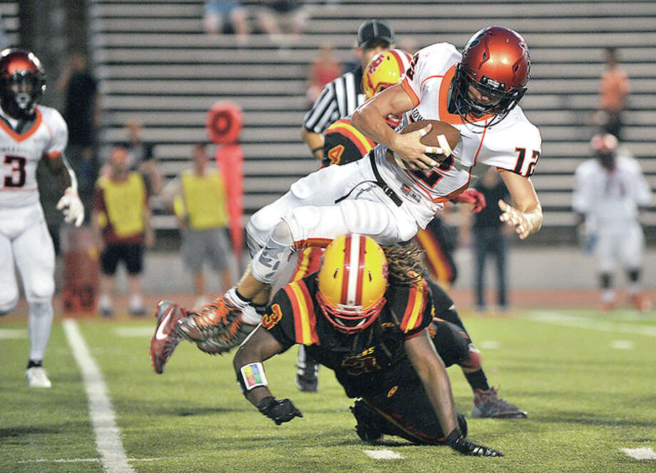 Edwardsville's Grant Bradley is upended by Rock Island's Tre NimmersFriday night in Rock Island. Photo: Paul Colletti, Rock Island Argus | For The Telegraph