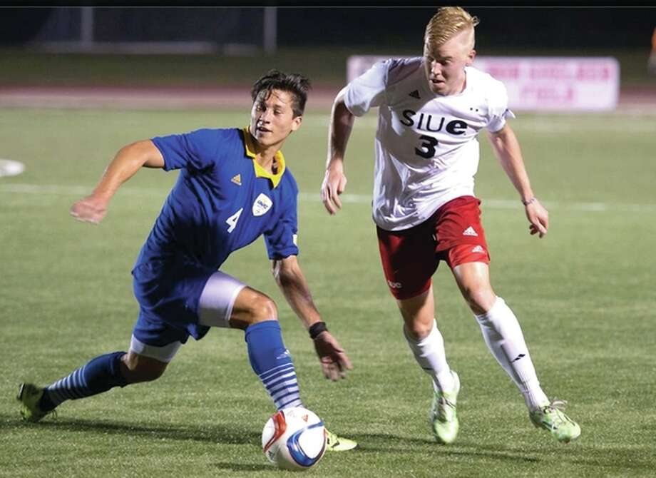 SIUE's Justin Bilyeu, right, battles with Roberto Albuquerque of UMKC for the ball Friday night at Korte Stadium. Photo: SIUE Photo