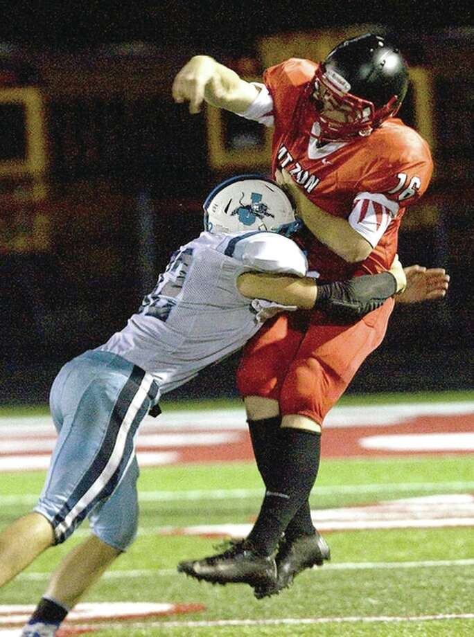 Jersey's Connor Norris gets to Mount Zion quarterback JJ Aldridge just as he releases the ball during action Friday night in Mount Zion. Photo: Photo By Lisa Morrison, Decatur Herald & Review