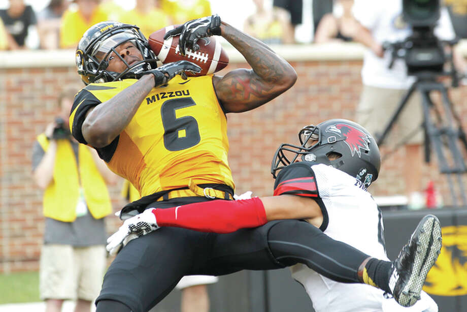 Missouri wide receiver J'Mon Moore (6) catches a touchdown pass over Southeast Missouri State cornerback Michael Ford (4) Saturday at Faurot Field in Columbia, Mo. Photo: Billy Hurst | For The Telegraph