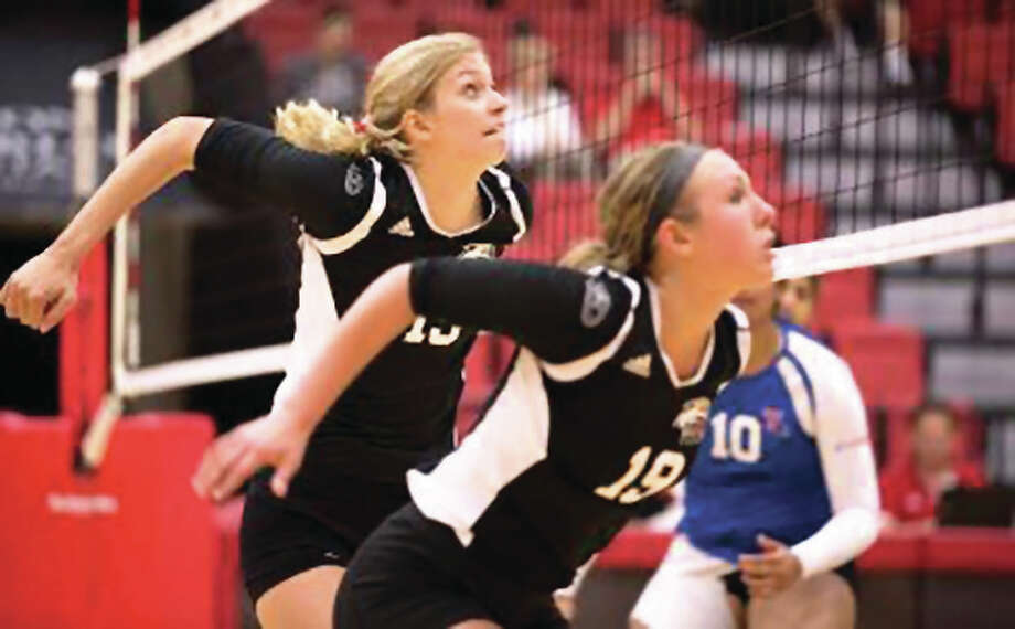 SIUE's Kristen Torre (left) and Mallory Mangun set to put up a block during Saturday's match against Louisiana Tech in the SIUE Tournament at Vadalabene Center in Edwardsville. Torre was named to the all-tourney team. Photo: SIUE Athletics